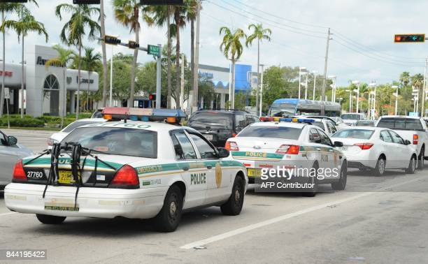 Police are seen in a traffic jam as people leave town during preparations for hurricane Irma in Miami Florida on September 8 2017 Florida Governor...