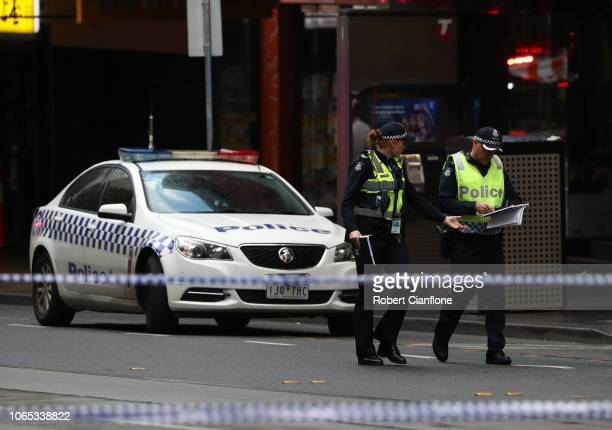 Police are seen in Bourke St on November 09 2018 in Melbourne Australia A man has been shot by police after setting his car on fire and stabbing...