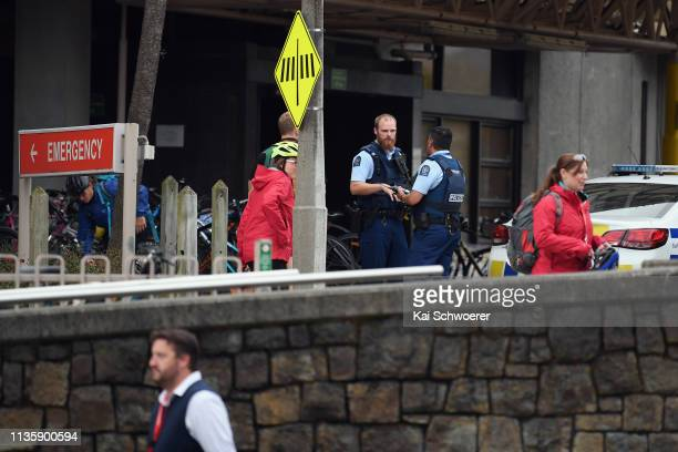 Police are seen in front of Christchurch Hospital during a lockdown on March 15 2019 in Christchurch New Zealand Four people are in custody following...