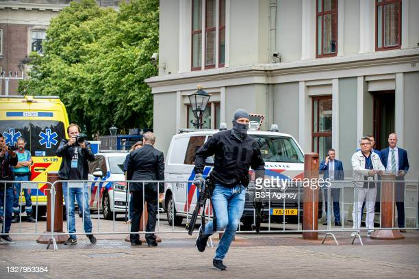 Police are seen near the Binnenhof which was cleared because a man poured gasoline over himself and threatened to set himself on fire on July 9, 2021...