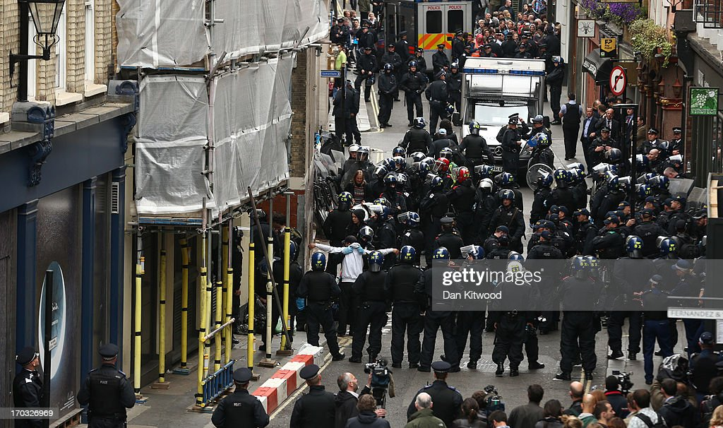 Police are seen on Beak Street as a man is searched as arrests are reportedly made as activists occupy a convergence centre of the Stop G8 protest group off Beak Street ahead of next week's G8 summit in Northern Ireland on June 11, 2013 in London, England. Next week will see Enniskillen in Northern Ireland host the two day G8 summit where international leaders including Britain's Prime Minister David Cameron and US President Barack Obama take part in the two day event. The chosen location is only 8 kilometers from the scene of one of Northern Ireland's worst killings back in 1987, however Cameron is confident that it's secluded location will deter any potential trouble.