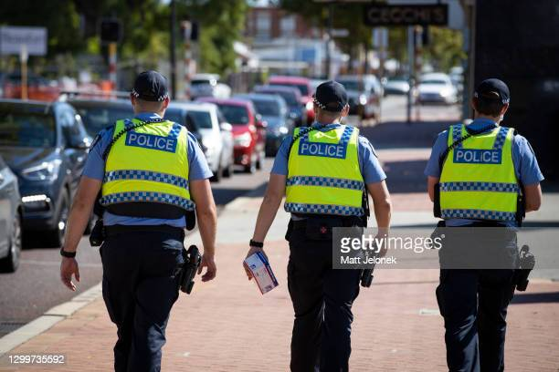 Police are seen on patrol at a Covid-19 drive through clinic in Inglewood where members of the public have been waited over two hours in line on...