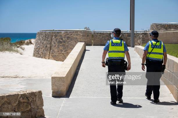 Police are seen on patrol at Scarborough Beach on February 01, 2021 in Perth, Australia. Lockdown restrictions are now in place across the Perth,...