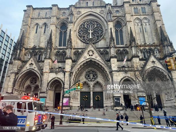 Police are seen outside of the Cathedral of St. John the Divine in New York on December 13 after a shooter opened fire outside the church before...