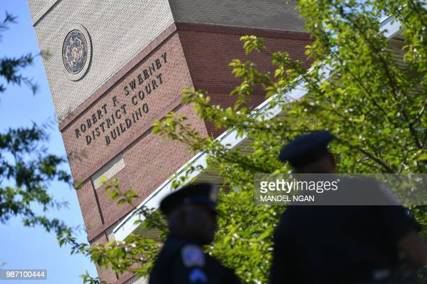 Police are seen outside the Robert F. Sweeney District Court in Annapolis, Maryland, on June 29 where suspected shooter Jarrod Ramos is expected to...