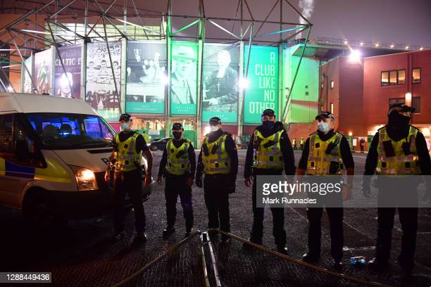 Police are seen outside the stadium following the Betfred Cup match between Celtic and Ross County at Celtic Park on November 29, 2020 in Glasgow,...
