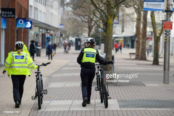 Police are seen patrolling around the city centre on December 31, 2020 in Portsmouth, England. From Thursday, three-quarters of the population of...