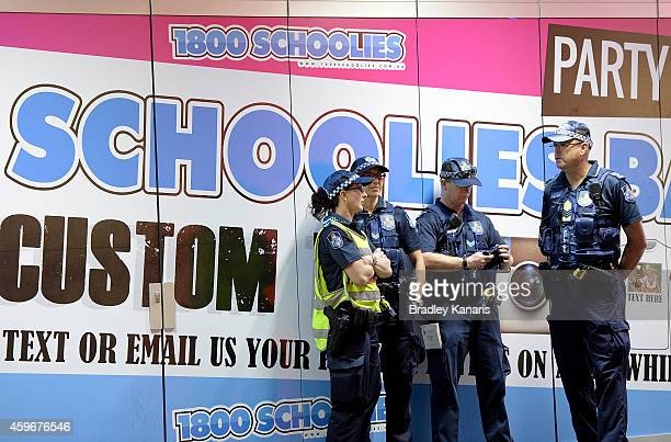 Police are seen patrolling the area during Australian 'schoolies' celebrations following the end of the year 12 exams on November 28 2014 in Gold...
