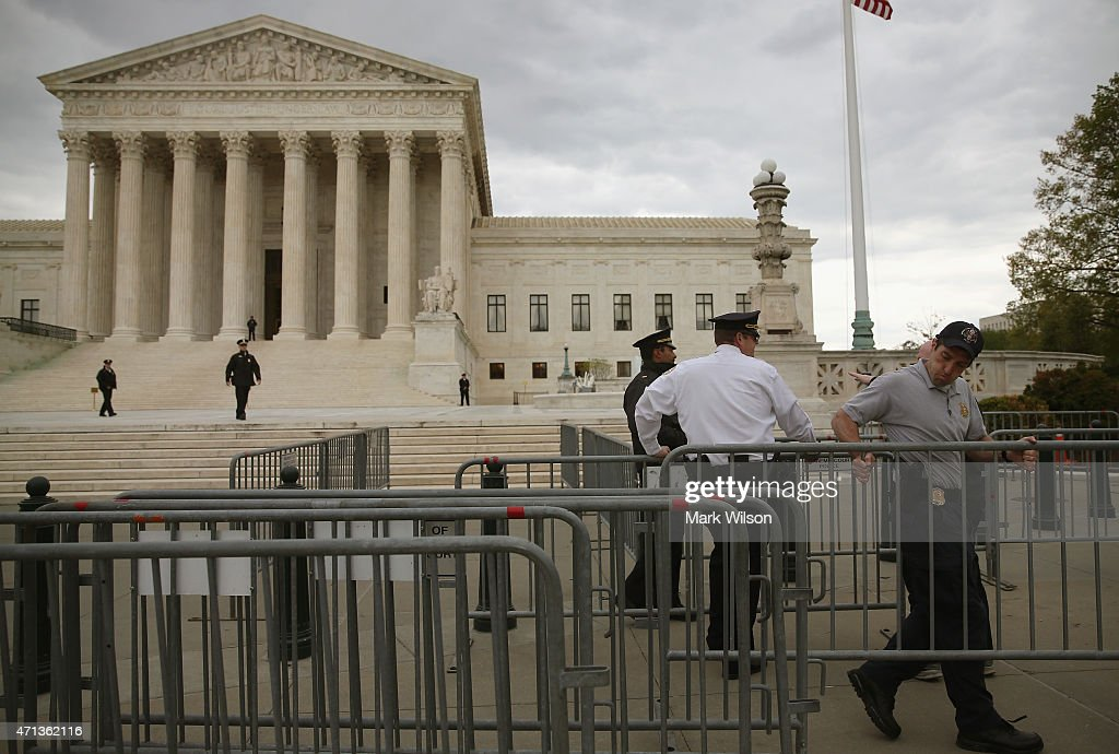 Police are setting up barracades before tomorrow's hearing on gay marriage at the U.S. Supreme Court April 27, 2015 in Washington, DC. The high court is scheduled to hear arguments April 28, in the case of Obergefell v. Hodges, that will ultimately decide whether states will still be allowed to ban same sex marriage and refuse to recognize the rights of couples married in other states.