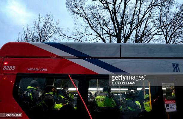 Police are transported by bus on January 6 to the US Capitol in Washington, DC. - Demonstrators breeched security and entered the Capitol as Congress...