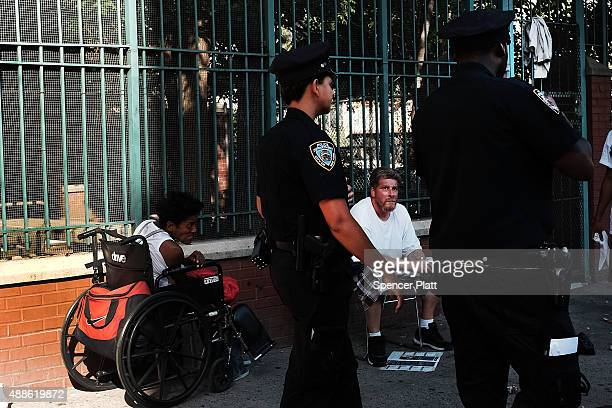Police are viewed in an area which has witnessed an explosion in the use of K2 or 'Spice', a synthetic marijuana drug, in East Harlem on September...