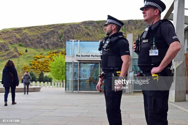 Police armed with Taser electroshock weapons patrol outside the Scottish Parliament on April 27 2017 in Edinburgh Scotland These and other new...