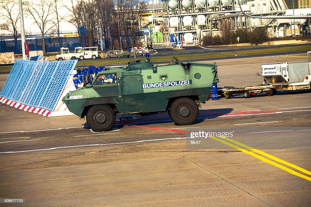 Police armored  protection vehicle in International Frankfurt Airport, : Stock Photo