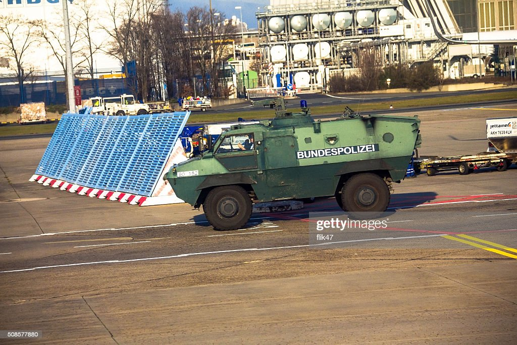 Police armored  protection vehicle in International Frankfurt Airport : Stock Photo