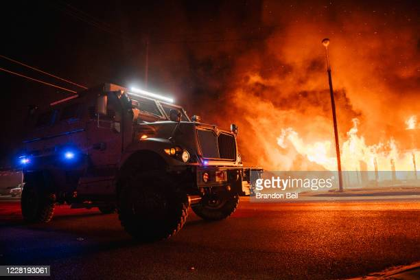 Police armored vehicle patrols an intersection on August 24, 2020 in Kenosha, Wisconsin. This is the second night of rioting after the shooting of...