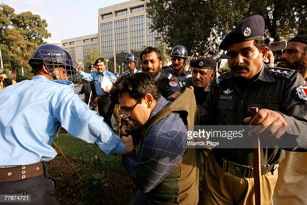 Police arrest a civil rights activist at an antigovernment protest on November 4 2007 in Islamabad Pakistan A small group of protesters held signs...
