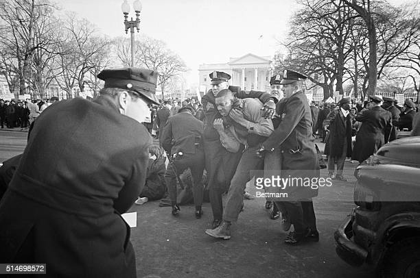 Police arrest a civil rights protester involved in a protest that blocked traffic on Pennsylvania Avenue in Washington DC