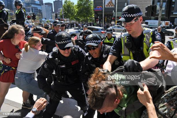 Police arrest a climate change protester attempting to disrupt the International Mining and Resources Conference being held in Melbourne on October...