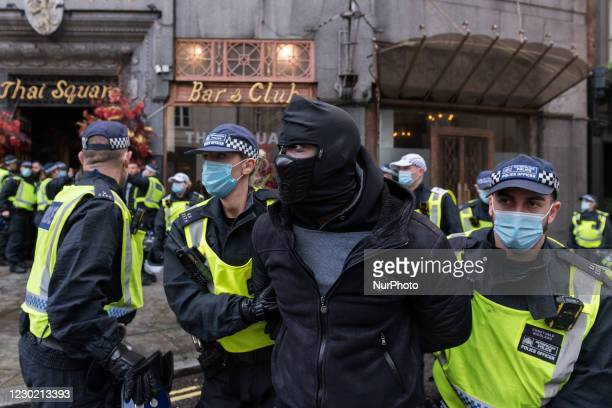 Police arrest a demonstrator during a protest in Westminster against the restrictions and legislations imposed by the Government to control the...