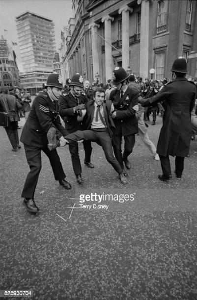 Police arrest a demonstrator during an anti-apartheid demonstration in Trafalgar Square, London, 26th October 1970.
