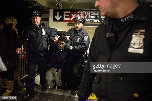 Police arrest a demonstrator protesting the Staten Island, New York grand jury's decision not to indict a police officer involved in the chokehold...