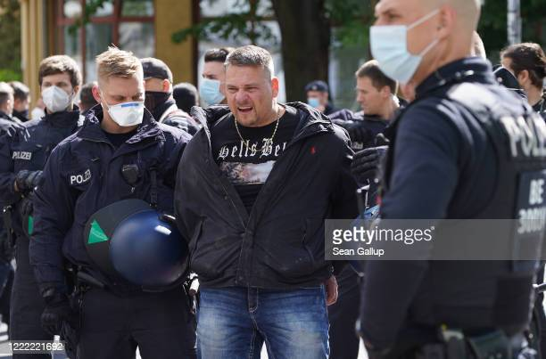 Police arrest a demonstrator who took part in a protest against government lockdown measures on May Day during the novel coronavirus crisis on May 1...
