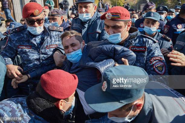 Police arrest a man as protesters demand the removal of Armenian Prime Minister Nikol Pashinyan from office in Freedom Square on November 11, 2020 in...