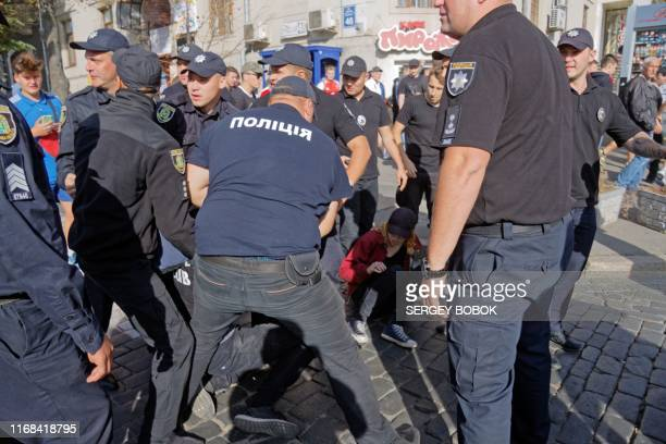 Police arrest a person after attacking LGBT community activists during the Kharkiv Pride March in the Ukrainian city of Kharkiv on September 15 2019