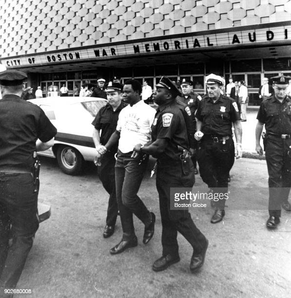 Police arrest a proBiafra demonstrator outside of the World Health Assembly at the War Memorial Auditorium in Boston on July 21 1969 Demonstrators...
