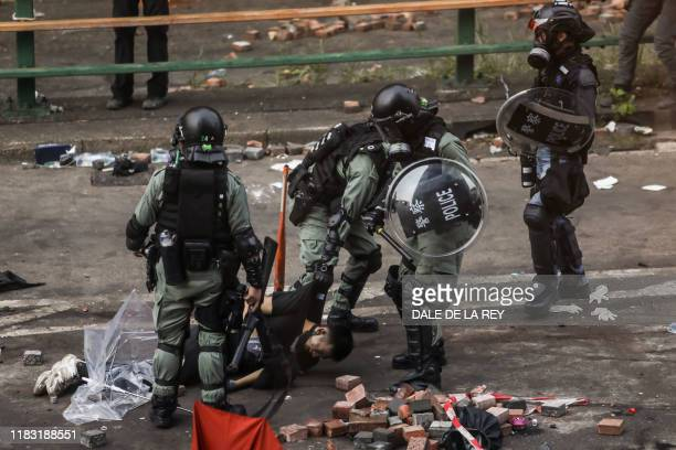 Police arrest a protester at the Hong Kong Polytechnic University in Hung Hom district of Hong Kong on November 18, 2019. - Pro-democracy...