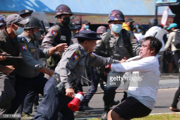Police arrest a protester during a demonstration against the military coup in Mawlamyine in Mon State on February 12, 2021.