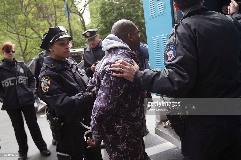 Police arrest a protester during an ACT-UP and Occupy Wall Street demonstration on April 25, 2012 in New York City. Police arrested several protesters who chained themselves to toilets and furnature in the street, saying that people with AIDS are 'being kicked to the curb' by Mayor Bloomberg due to recent policy changes in New York City. ACT-UP (AIDS Coalition to Unleash Power), was marking their 25-year anniversary in supporting services for people with AIDS worldwide. They were joined by Occupy Wall Street protesters in a march from New York's city hall to Wall Street. The groups called for a tax on Wall Street transactions and speculative trades to raise money for to end the global AIDS epidemic and provide universal healthcare in the U.S.