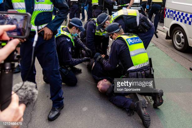 Police arrest a protester during the Coronavirus Anti-Lockdown Protest at Parliament House on 10 May, 2020 in Melbourne, Australia.