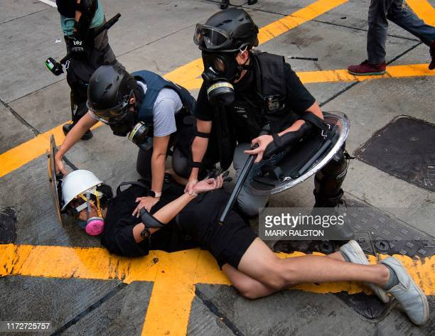 Police arrest a protester in the Wanchai area of Hong Kong on October 1 as the city observes the National Day holiday to mark the 70th anniversary of...