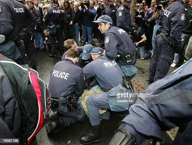 Police arrest a protestor during a 'Stop Bush Make Howard History Rally' held at Sydney Town Hall September 8 2007 in Sydney Australia The...