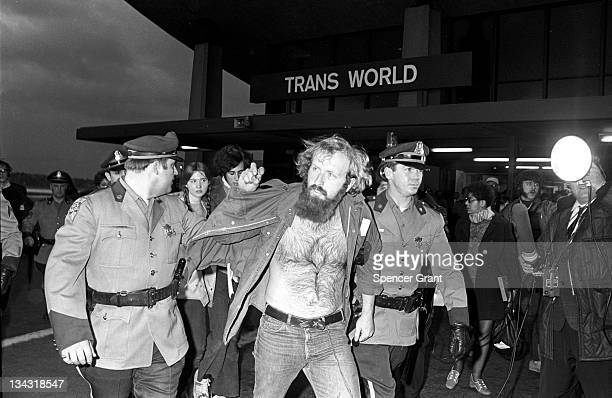 Police arrest a protestor during an Earth Day Demonstration at Boston's Logan Airport 1970