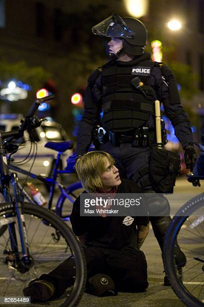 Police arrest a protestor outside the Rage Against the Machine concert at the Target Center on September 3 2008 in Minneapolis Minnesota The...