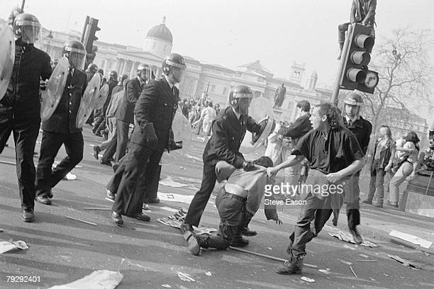 Police arrest a rioter in Trafalgar Square during violence which arose from a demonstration against the Poll Tax London 31st March 1990