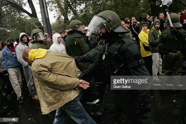 Police arrest a soccer fan for misconduct as fans of soccer team Dynamo Dresden look on outside the Rodulf Harbig Stadium prior to Dynamo Dresden's...