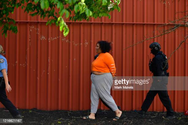 Police arrest a woman during widespread unrest following the death of George Floyd on May 31 2020 in Philadelphia Pennsylvania Protests have erupted...