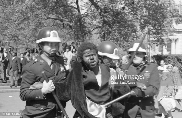 Police arrest an AfricanAmerican protester whose face is bloodied following a confrontation with police during an anti Vietnam War protest near 14th...