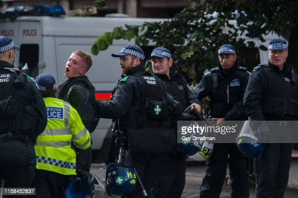 Police arrest an anti fascist on September 7 2013 in London United Kingdom Antifascists protesting against farright activist Tommy Robinson in...