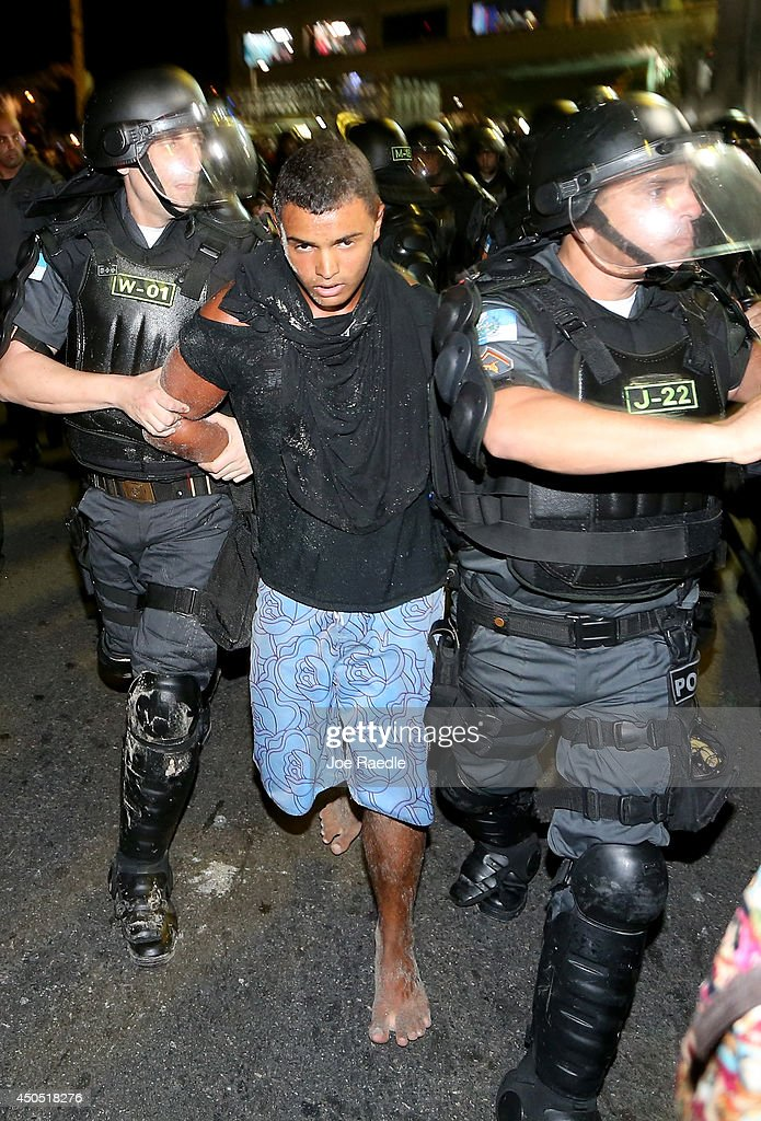 Police arrest an anti-World Cup protester during their march on Copacabana beach on June 12, 2014 in Rio de Janeiro, Brazil. Brazil defeated Croatia 3-1 in the first match of 2014 FIFA World Cup today.