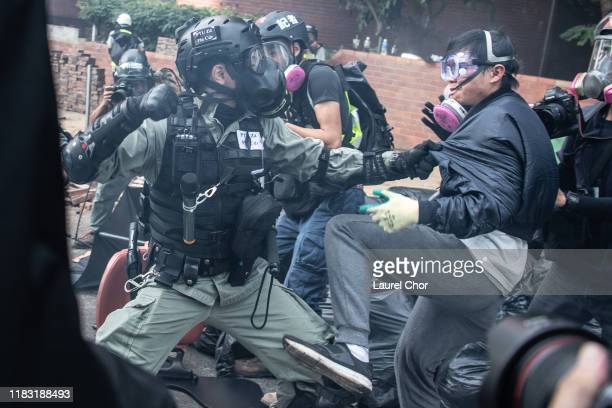 Police arrest antigovernment protesters at Hong Kong Polytechnic University on November 18 2019 in Hong Kong China Antigovernment protesters armed...