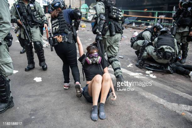 Police arrest anti-government protesters at Hong Kong Polytechnic University on November 18, 2019 in Hong Kong, China. Anti-government protesters...