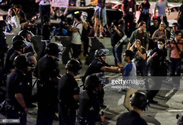 Police arrest demonstrators after they shut down the 101 Freeway a major thoroughfare in the city following a rally to protest a day after...