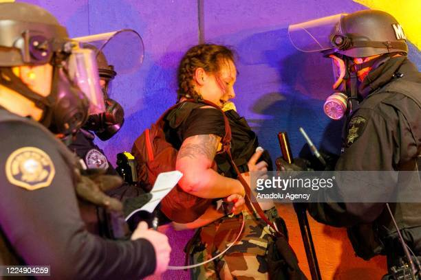 Police arrest demonstrators as Black Lives Matter supporters demonstrate in Portland, Oregon on July 4, 2020 for the thirty-eighth day in a row at...