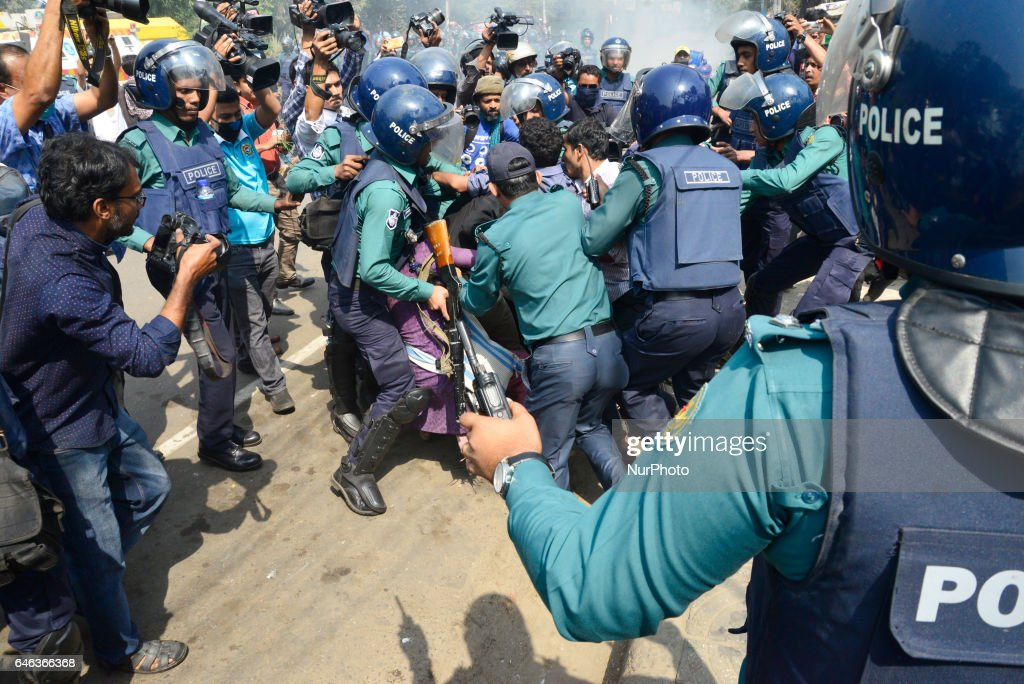 "Police arrest demonstrators during the shutdown against gas tariff hike in Dhaka, Bangladesh on February 28, 2017. Activists from the ""Progressive Student Alliance"" , the student wing of the Communist Party of Bangladesh (CPB) and the Bangladesher Samajtantrik Dal (BSD) along a coalition of left-leaning political party organized the strike after the Bangladesh Energy Regulatory Commission announce increase of gas price. During the protest, police use tear gas canisters and water cannon to disapear the protestors from the streets. At least 10 demonstrators have been detained on Tuesday from Dhaka's Shahbagh."