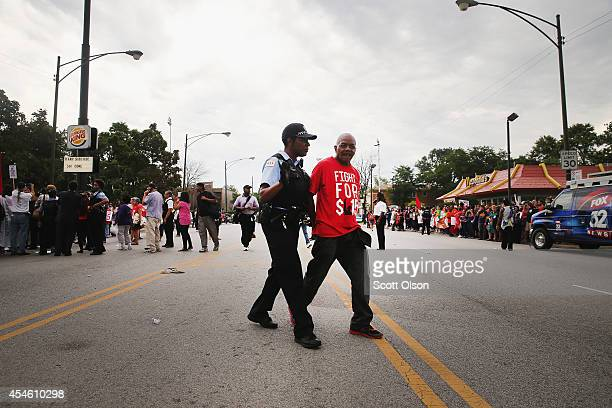 Police arrest demonstrators who were protesting for an increase in wages for fast food workers and home care workers after they staged a sitin on...