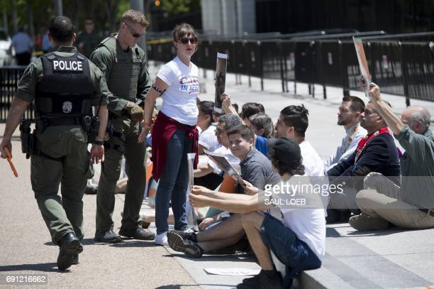 Police arrest demonstrators with the organization CASA as they protest US President Donald Trump's immigration and deportation policies during a...